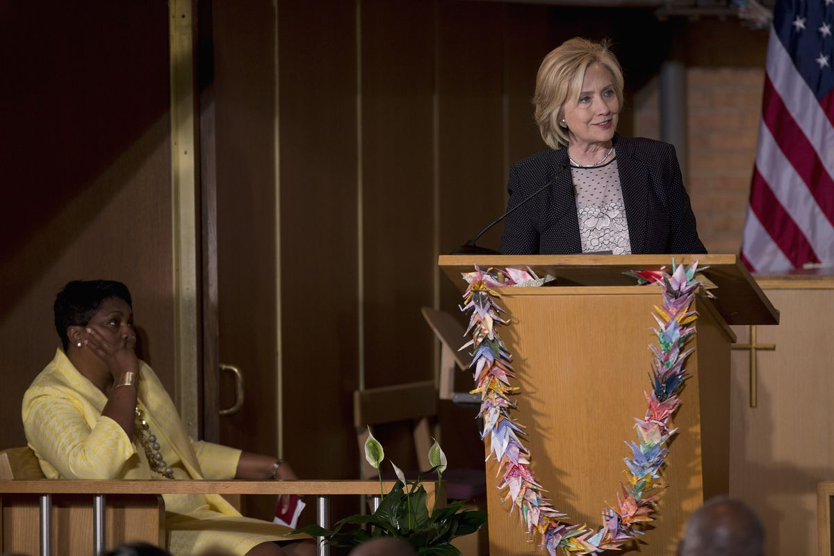 Pastor Traci Blackmon (L) listens as Democratic presidential candidate and former U.S. Secretary of State Hillary Clinton speaks to supporters on June 23, 2015 at Christ the King United Church of Christ in Florissant, Missouri.