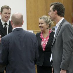 Prosecutors Jared Perkins, left, and Chad Grunander speak with defense attorneys Susanne Gustin and Randall Spencer during the murder trial of Martin MacNeill in Provo's 4th District Court on Friday, Nov. 8, 2013.