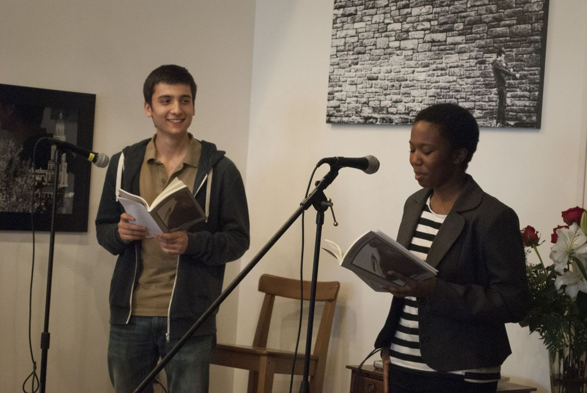 Nafassho Nafasshoev and Memphis Washington reading from CONTRARIWISE, a student-written philosophy journal.