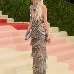 Poppy Delevingne wears a Marchesa gown.