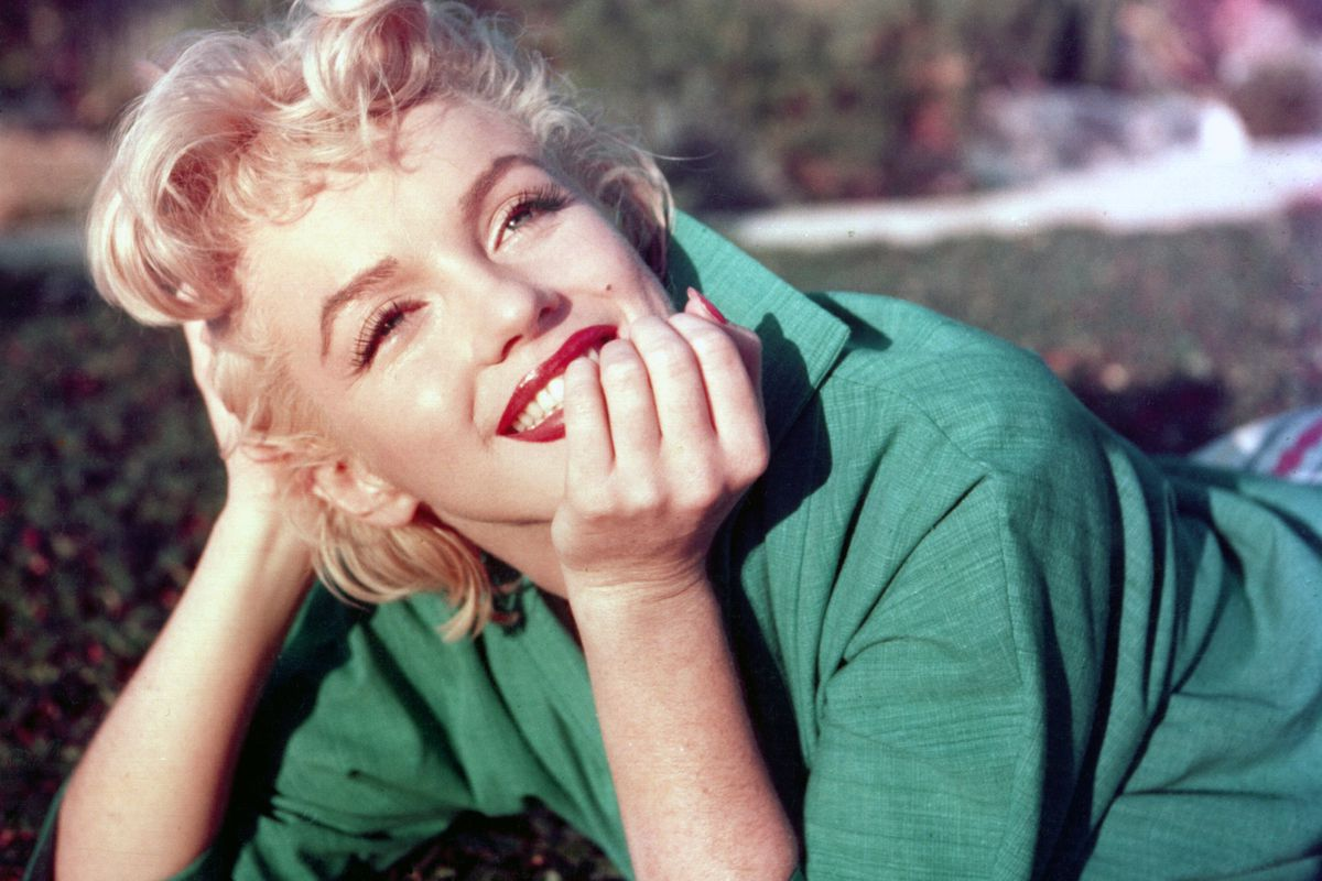 Marilyn Monroe, wearing her signature lip color.