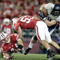 Utah State's Kellen Bartlett (81) catches a pass in front of Wisconsin's Chris Borland (44) and Mike Taylor (53) during the second half of an NCAA college football game Saturday, Sept. 15, 2012, in Madison, Wis. Wisconsin won 16-14. (AP Photo/Morry Gash)
