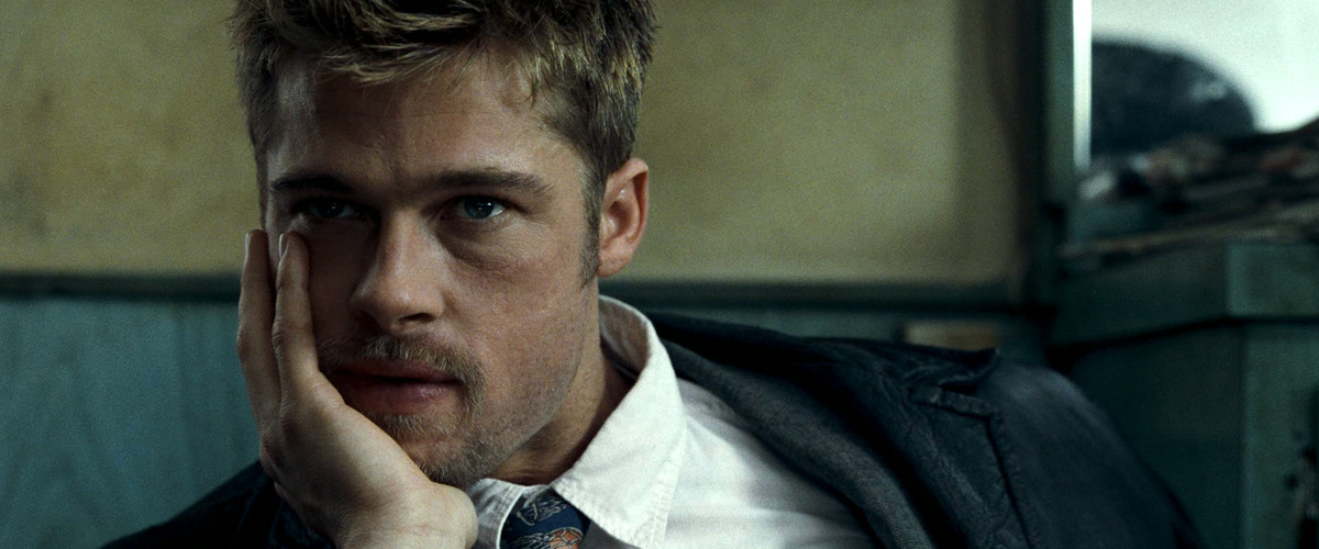 seven: brad pitt's detective rests his chin on his hand in deep thought