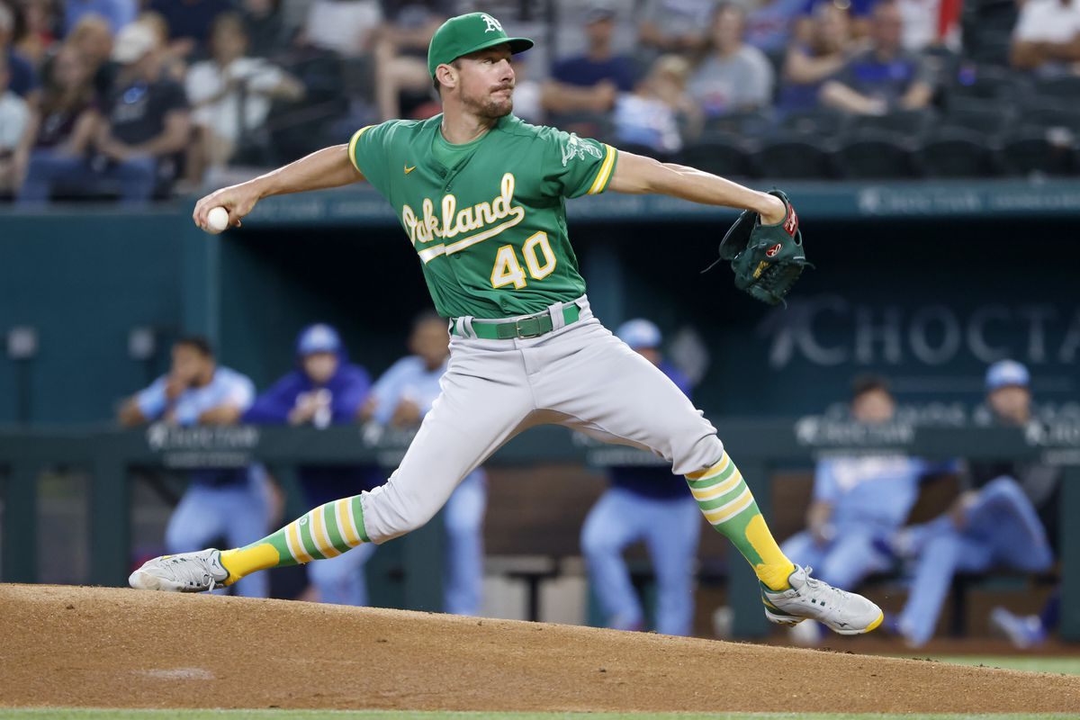 Chris Bassitt #40 of the Oakland Athletics pitches against the Texas Rangers during the first inning at Globe Life Field on July 11, 2021 in Arlington, Texas.