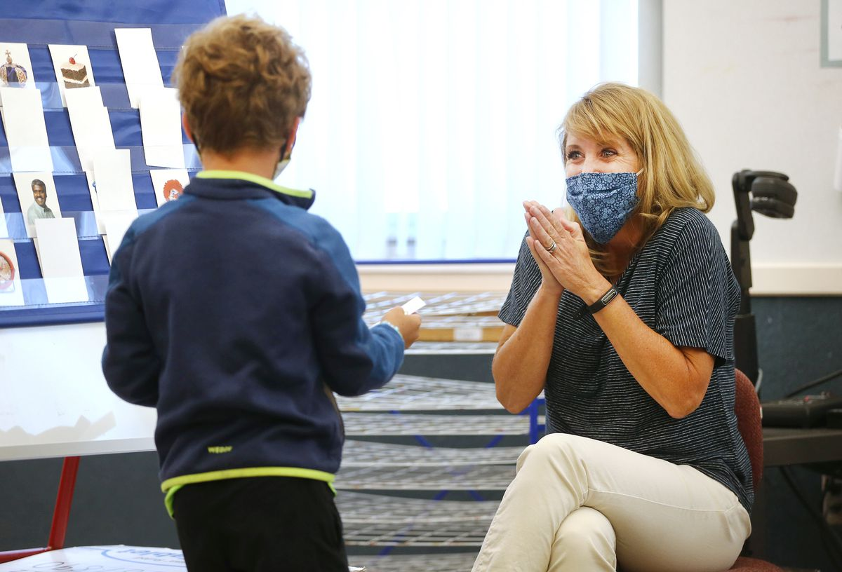 Teacher Beth Walz celebrates during a match game with Malo, a French-speaking student learning English, at J.E. Cosgriff Memorial Catholic School in Salt Lake Cityon Monday, June 22, 2020. The school is offering a modest summer program for students.