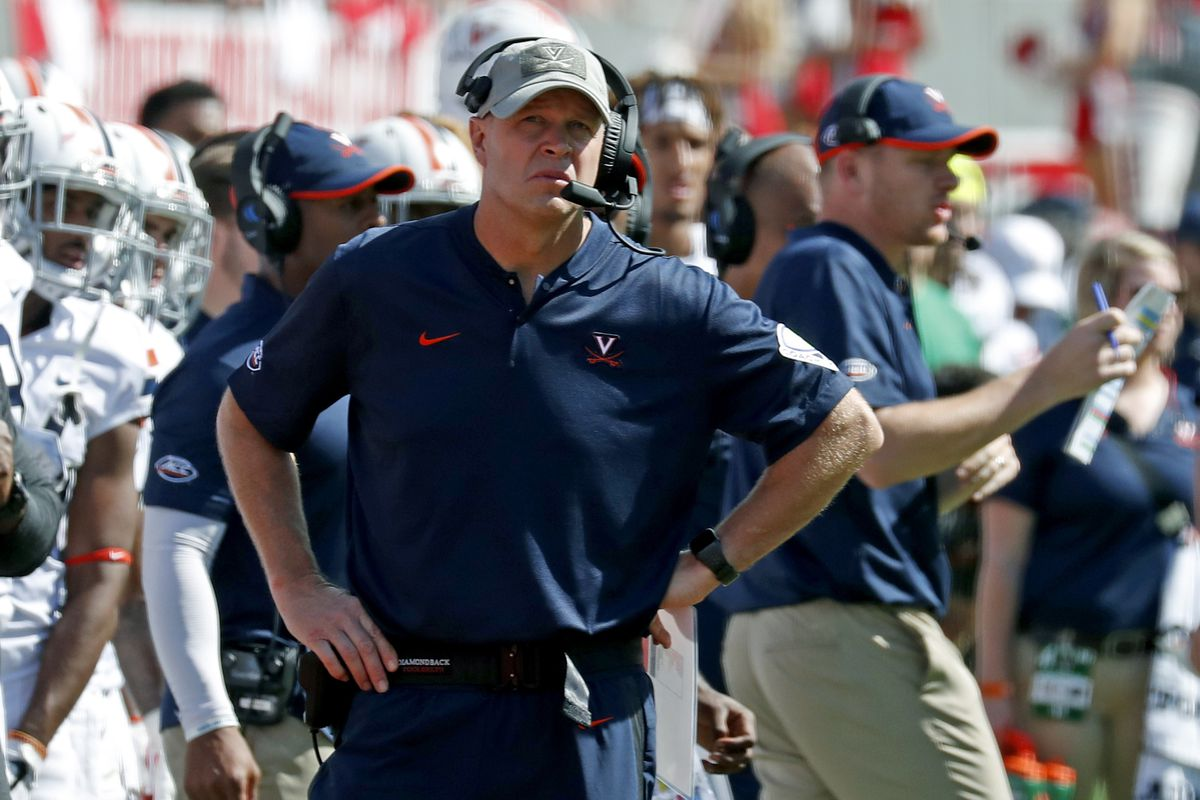 FILE - In this Saturday, Sept. 29, 2018, file photo, Virginia head coach Bronco Mendenhall watches the action during the second half of an NCAA college football game in Raleigh, N.C. Virginia's last meeting with Miami was on its way to being a highlight u