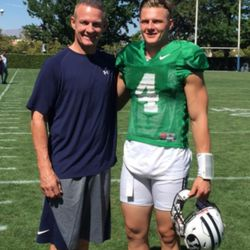 ESPN analyst, and former NFL player Merril Hoge talks with son, Beau, a BYU quarterback, during fall camp.