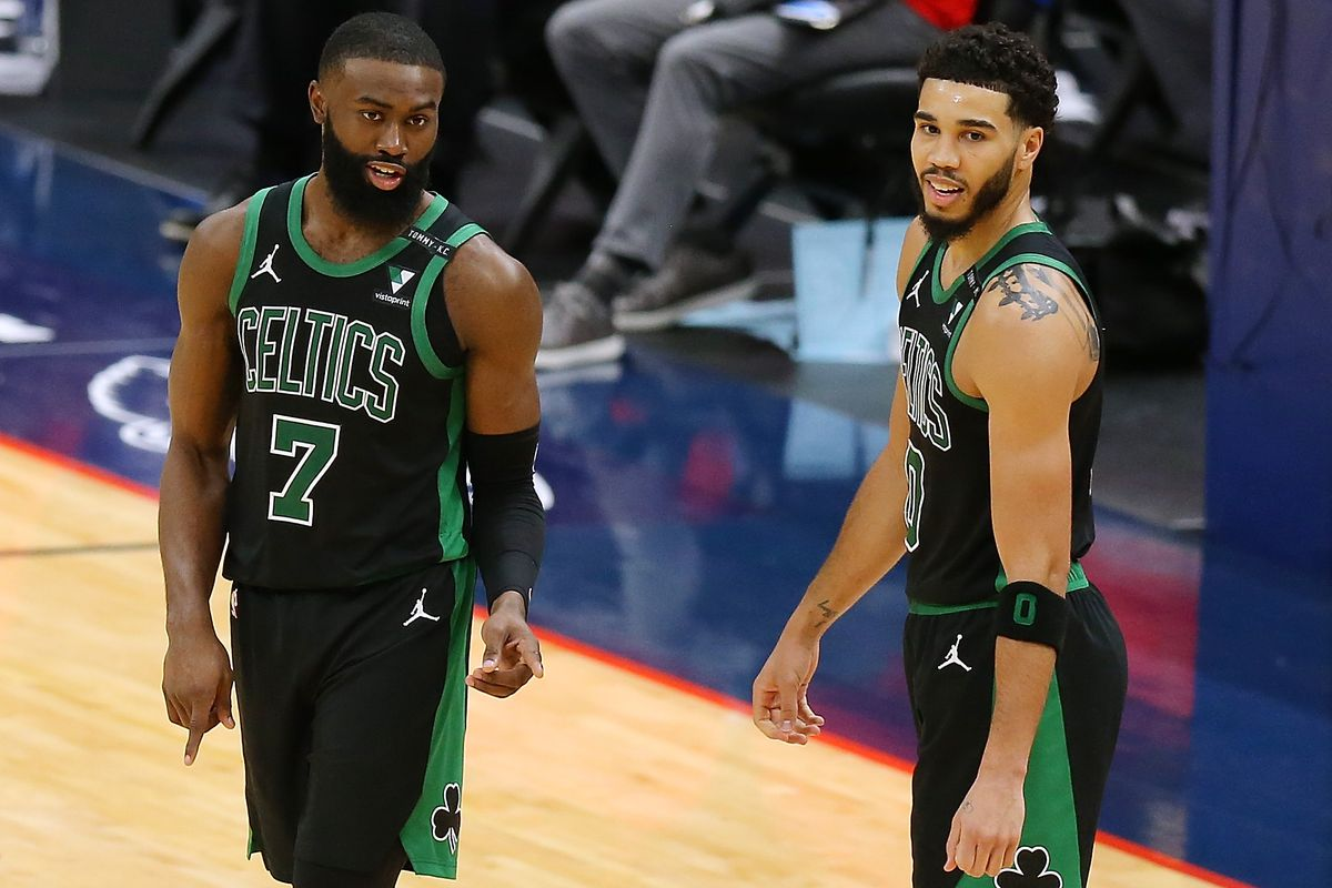 Jaylen Brown of the Boston Celtics and Jayson Tatum talk against the New Orleans Pelicans during a game at the Smoothie King Center on February 21, 2021 in New Orleans, Louisiana.