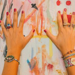 """<strong>Left Hand:</strong> 'Dark Angel' bracelet, $230; 'Eye' and 'Lip' rings, $85<br> <strong>Right Hand:</strong> 'Eye am Love' ring, $215; 'Baby Hold On' ring, $150; 'Theanine' bangle, <a href=""""http://www.susanalexandra.com/products/theanine-bracelet"""