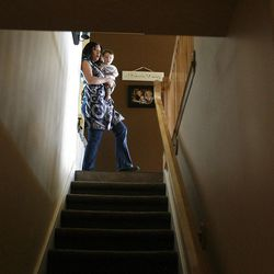 Jessica Bronson heads downstairs to her salon after her son, Blake, is done napping at their West Valley home on Tuesday, September 27, 2011.  Bronson is a self-employed hair stylist who works out of her home so that she can spend more time with her kids.
