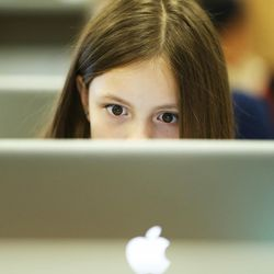 Julianna Martinez works out a problem on her computer at East Midvale Elementary on Monday, Sept. 25, 2017.