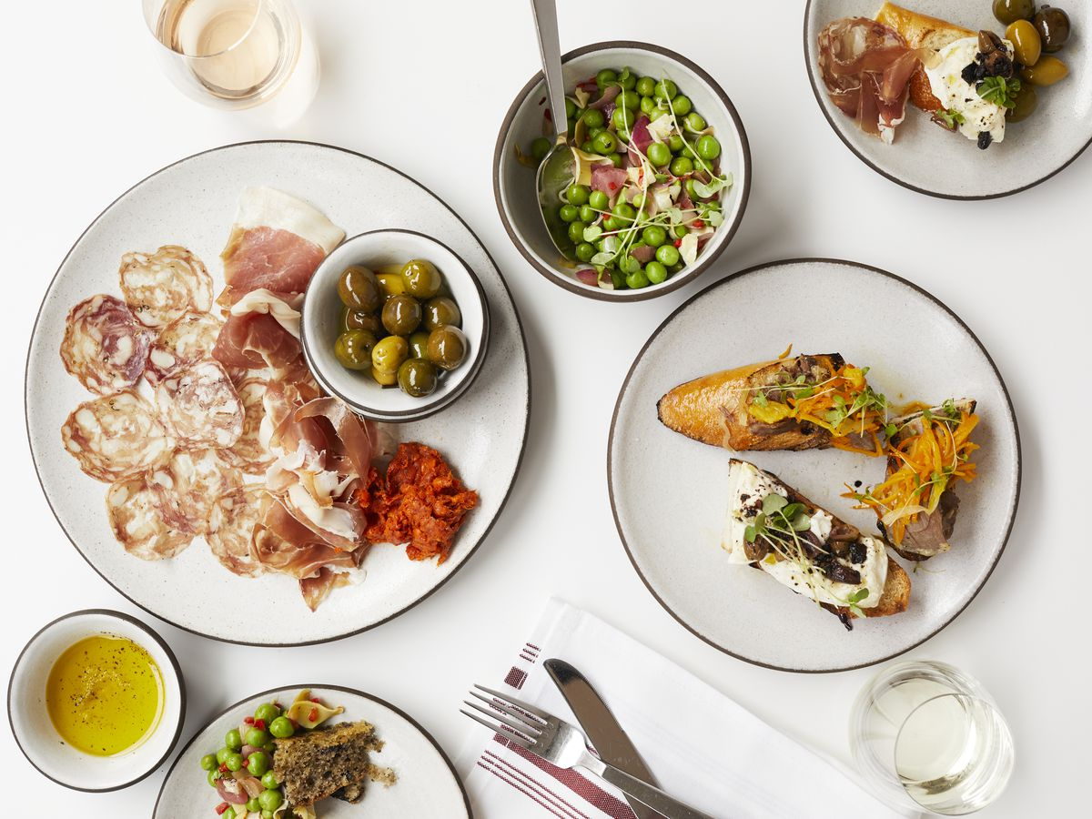 A spread of Italian dishes on a bright white surface