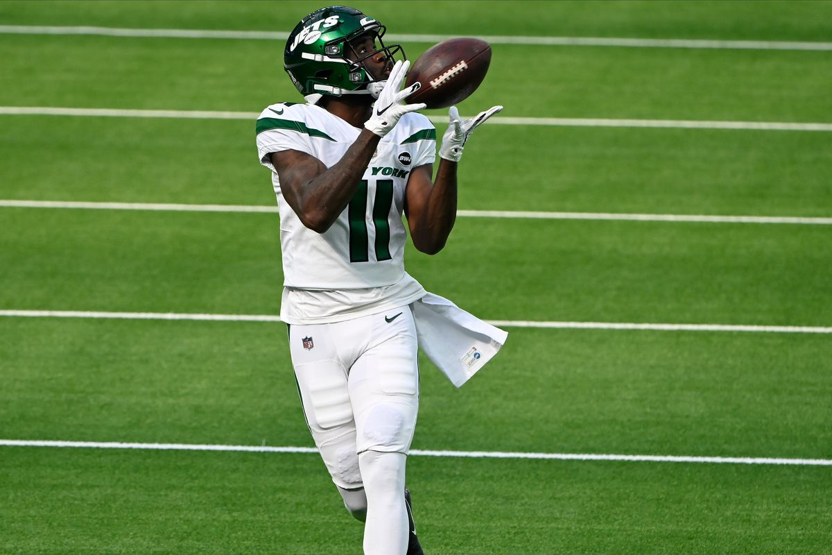 New York Jets wide receiver Denzel Mims (11) makes a catch during pre-game warmups before playing the Los Angeles Chargers at SoFi Stadium.