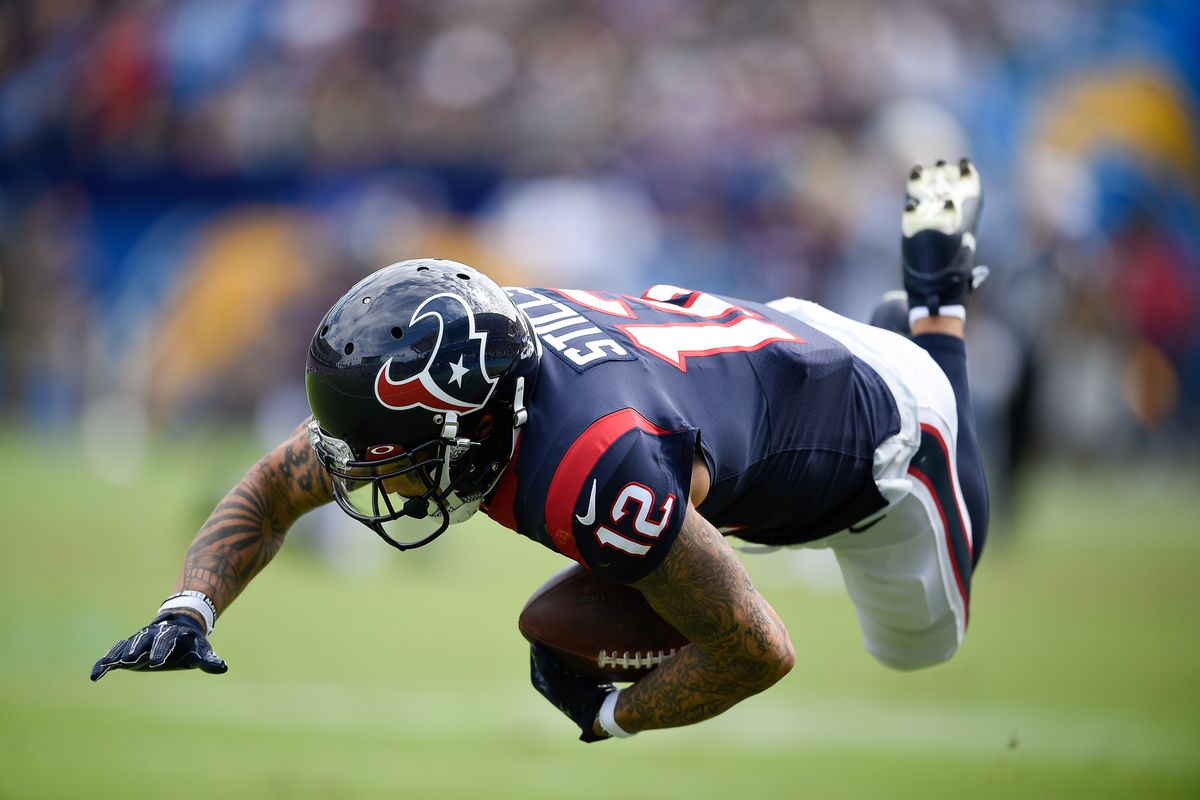 Houston Texans wide receiver Kenny Stills falls to the ground after a catch during the first half against the Los Angeles Chargers at Dignity Health Sports Park.