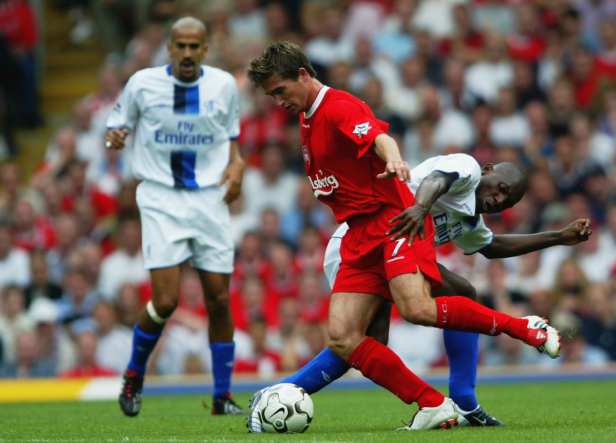 Harry Kewell of Liverpool is tackled by Geremi of Chelsea