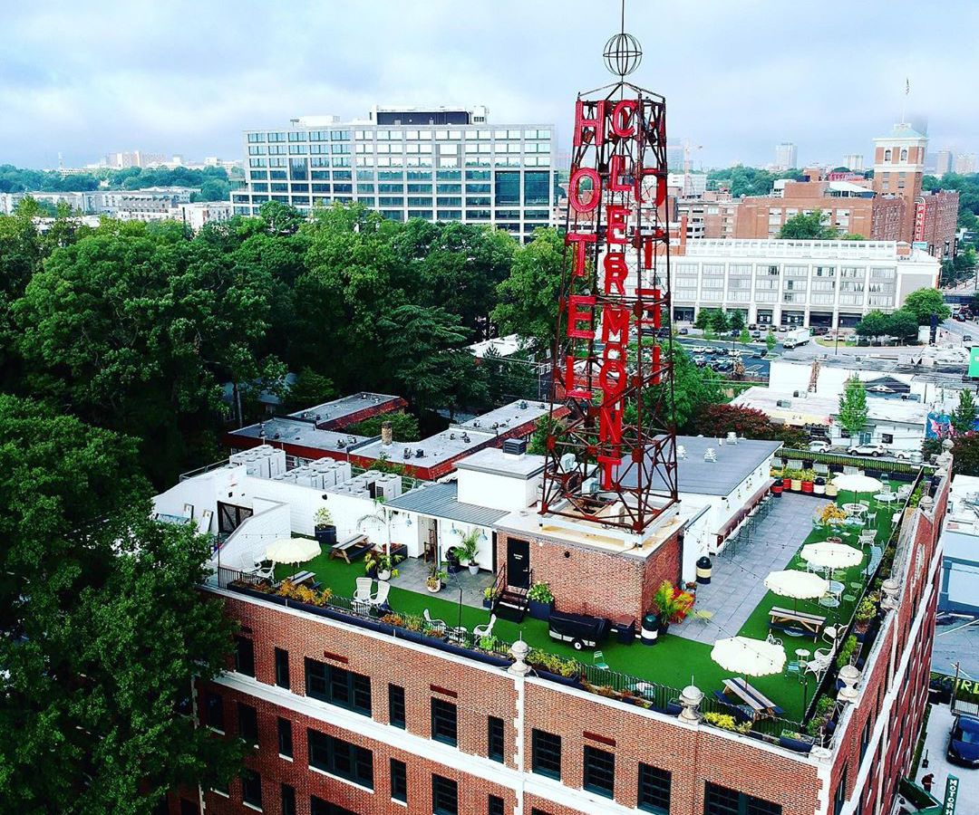 """Red tower atop a building with """"Hotel Clermont"""" on it."""
