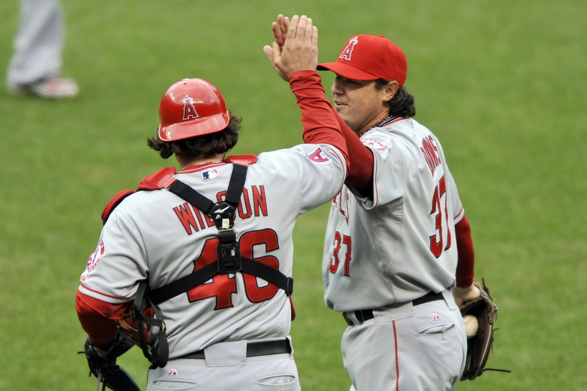 Apr 28, 2012; Cleveland, OH, USA; Los Angeles Angels relief pitcher Scott Downs (37) celebrates with catcher Bobby Wilson (46) after a 2-1 win over the Cleveland Indians at Progressive Field. Mandatory Credit: David Richard-US PRESSWIRE
