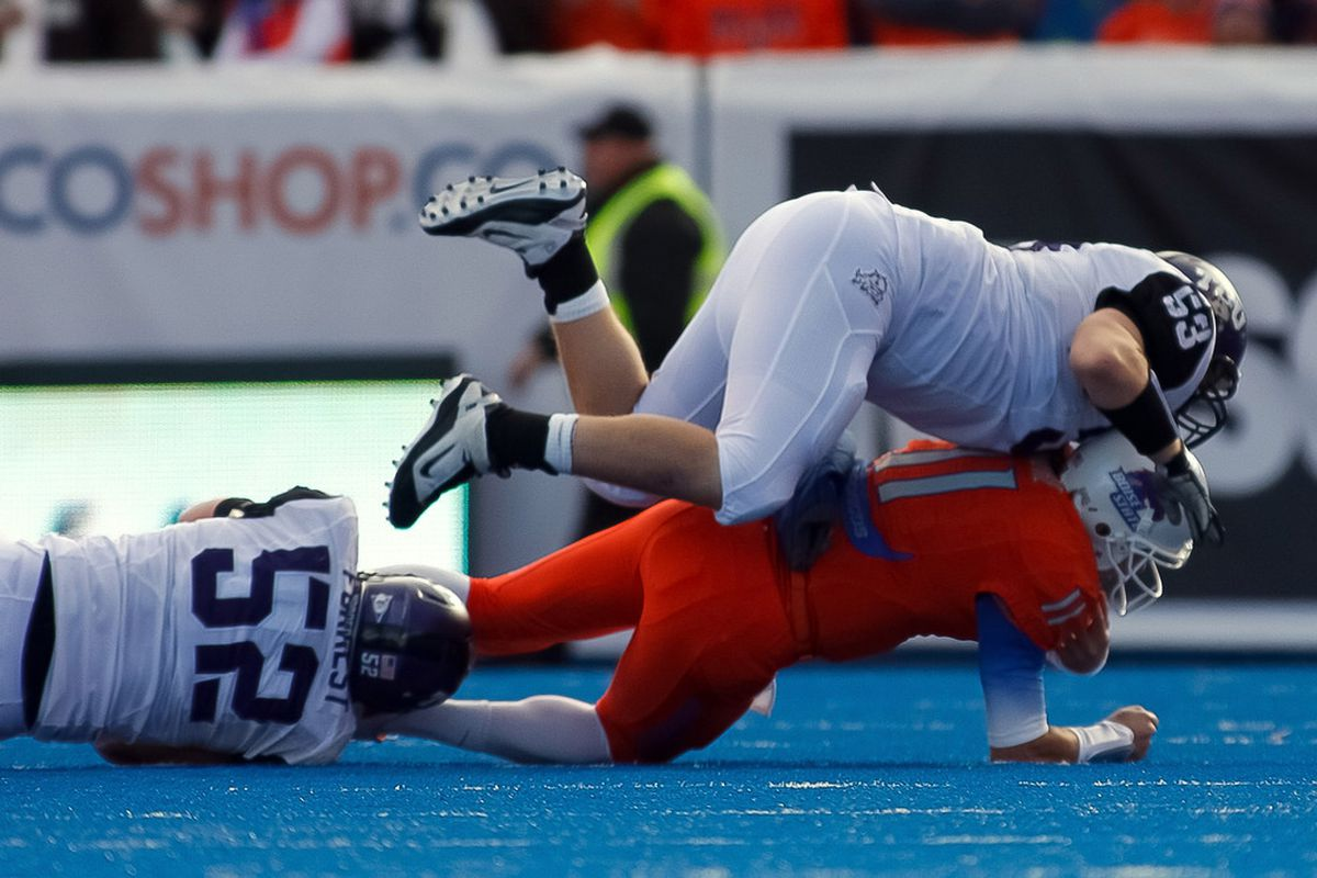 BOISE, ID - NOVEMBER 12:  Kellen Moore #11 of the Boise State Broncos is sacked by Ross Forrest #52 and David Johnson #53 of the TCU Horned Frogs.  What is the legacy of this sack?