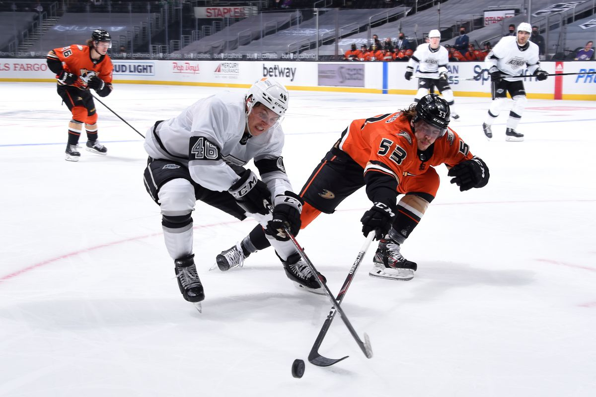 #46 of the Los Angeles Kings and Max Comtois #53 of the Anaheim Ducks battle for the puck during the second period at STAPLES Center on April 28, 2021 in Los Angeles, California.