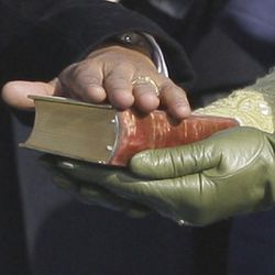 President Barack Obama rests his hand on President Lincoln's Inaugural Bible as  his wife Michelle Obama holds it as he takes the oath of office at the U.S. Capitol in Washington, Tuesday, Jan. 20, 2009.  (AP Photo/Elise Amendola)