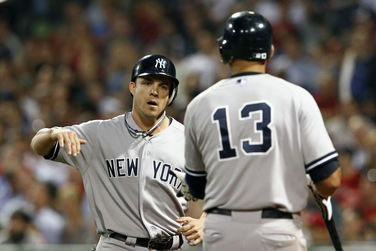 Sep 13, 2012; Boston, MA, USA; New York Yankees left fielder Steve Pearce (left) celebrates with third baseman Alex Rodriguez (13) after scoring a run against the Boston Red Sox during the seventh inning at Fenway Park. Mark L. Baer-US PRESSWIRE