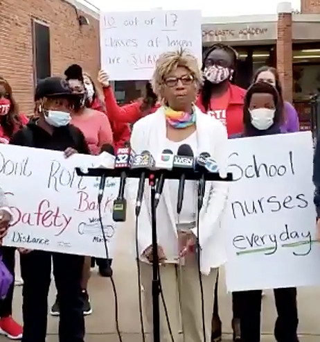Linda Jiles, a school nurse at Jensen Elementary on the West Side where more than half of students are under quarantine, calls for enhanced safety measures at a news conference Wednesday.