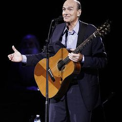 James Taylor performs at the EnergySolutions Arena on Thursday.