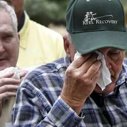 Cancer patients Randall Mansfield, right, and Randy Farrimond wipe away tears during the closing ceremony of the Reel Recovery fly-fishing retreat at Falcon's Ledge lodge near Altamont on May 29.