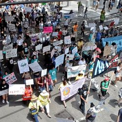 Protesters march Saturday along Clark StreetSaturday to protest ICE raids.