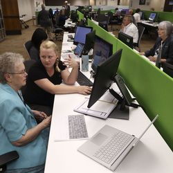 Sister Barbara Moon, left, receives help translating Swedish documents from Nordic researcher Savannah Larson at the family history library at The Church of Jesus Christ of Latter-day Saints in Salt Lake City on Tuesday July 6, 2021. The library reopened after being closed for 16 months.