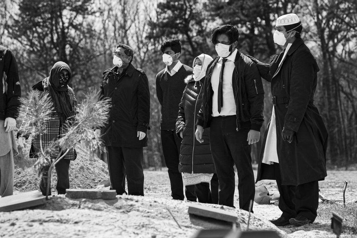 Mourners gather at one of the funerals.