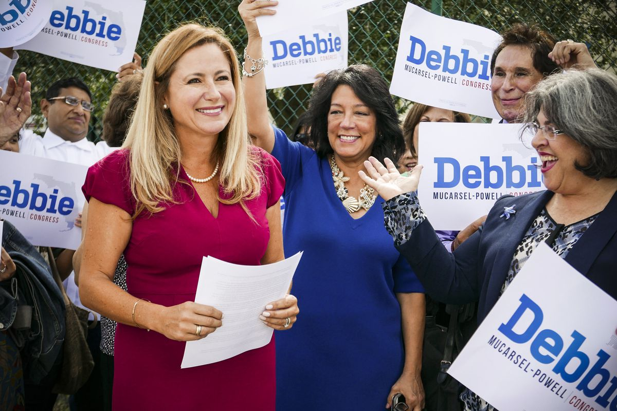 Surrounded by family and supporters, Democrat Debbie Mucarsel-Powell announces she is running against Rep. Carlos Curbelo (R-Fla.), outside the West Perrine Health Center in Miami, Florida, on August 2, 2017.