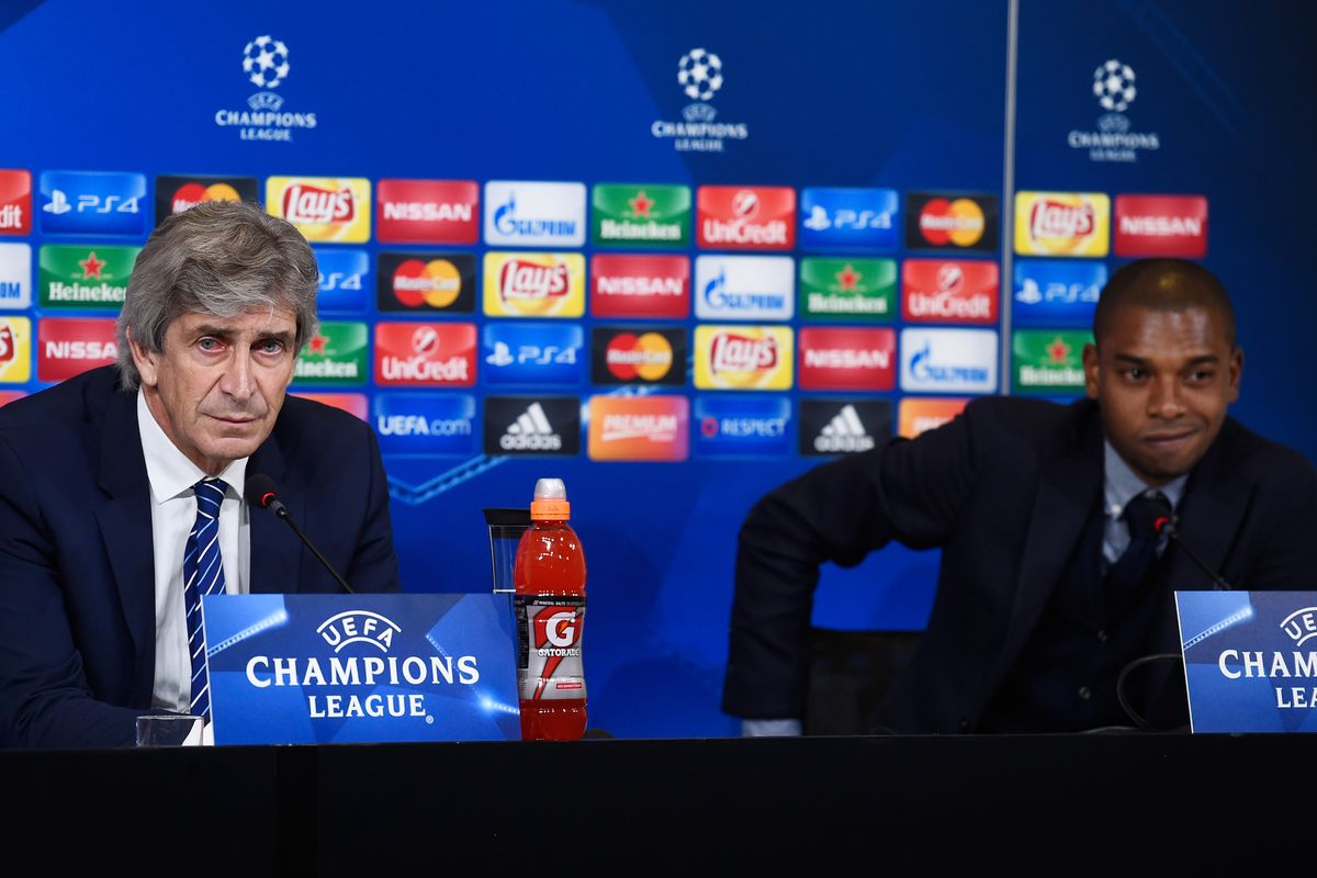 Manager Manuel Pellegrini and Fernandinho attend a Manchester City press conference ahead of the UEFA Champions League match against Juventus at Juventus Stadium on November 24, 2015 in Turin, Italy.