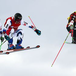 Kevin Drury, right, of Canada, Francois Place of France, Jean Frederic Chapuis of France and Johannes Aujesky of Austria fly over a jump during a semifinal of the skicross competition at the 2019 FIS World Championships at Solitude Mountain Resort on Saturday, Feb. 2, 2019.