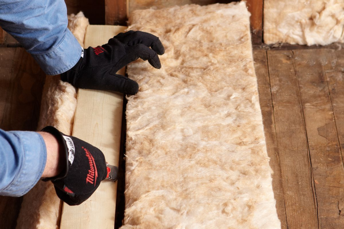 Cutting fiberglass insulation batts.