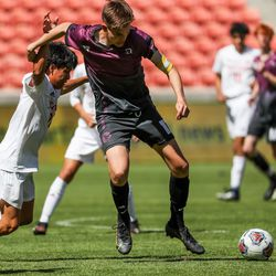 Judge Memorial's Nahuel Batalla and Morgan's Cole Terry compete for the ball in the 3A boys soccer championship at Rio Tinto Stadium in Sandy on Tuesday, May 18, 2021.