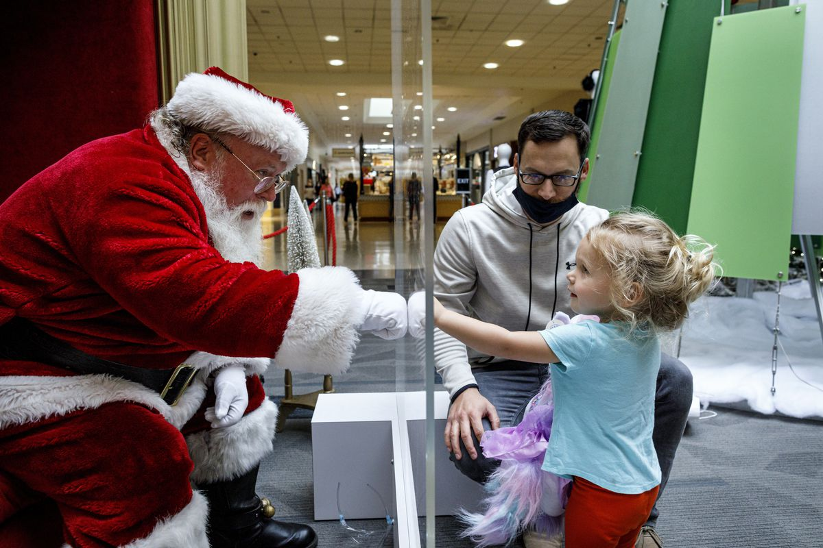 Tyler Rapsey with daughter Isabelle visits with Santa Claus, with safety protocols in place, at Capital City Mall in Lower Allen Township, Pa., on Wednesday, Nov. 11, 2020.
