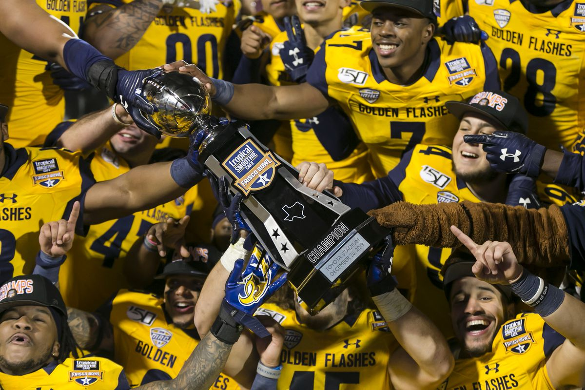 The Kent State Golden Flashes celebrate winning the Tropical Smoothie Cafe Frisco Bowl trophy after the game between the Utah State Aggies and the Kent State Golden Flashes on December 20, 2019 at the Toyota Stadium in Frisco, Texas.