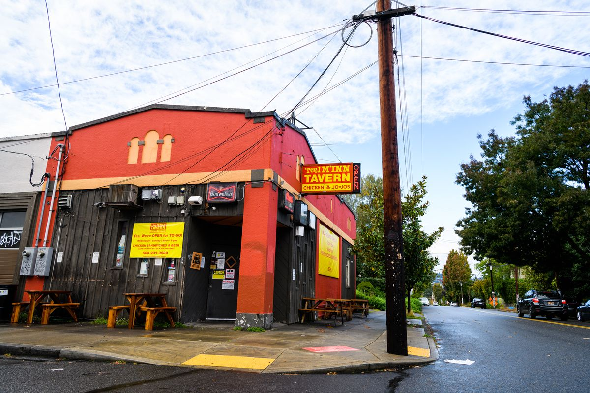 """A red building in Southeast Portland sports a sign that says """"Reel M Inn"""""""