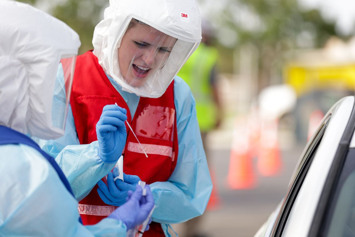 Sara Haight and Alta Findlay administer a COVID-19 test at a testing site run by the Salt Lake County Health Department at Glendale Middle School in Salt Lake City on Tuesday, Sept. 15, 2020.