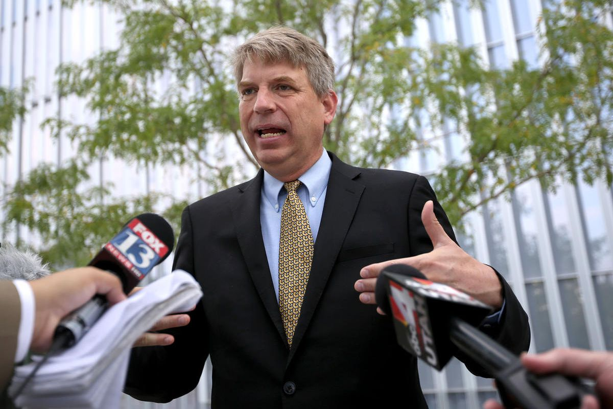 FILE - United Utah Party third congressional district candidate Jim Bennett talks to the media outside of the Federal Courthouse in Salt Lake City on Thursday, Aug. 3, 2017.