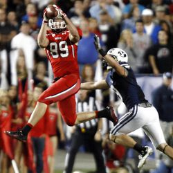 Utah Utes tight end Dallin Rogers (89) makes a reception for a first down with Brigham Young Cougars defensive back Daniel Sorensen defending as BYU and Utah play Saturday, Sept. 17, 2011
