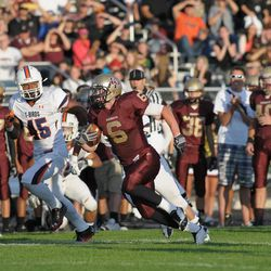 Lone Peak receiver Talon Shumway runs with the ball. Timpview reigned supreme over Lone Peak 36-33.