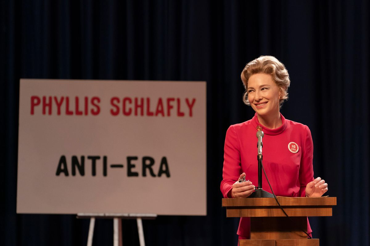 Cate Blanchett as Phyllis Schlafly standing in front of an Anti-Era sign in Mrs. America