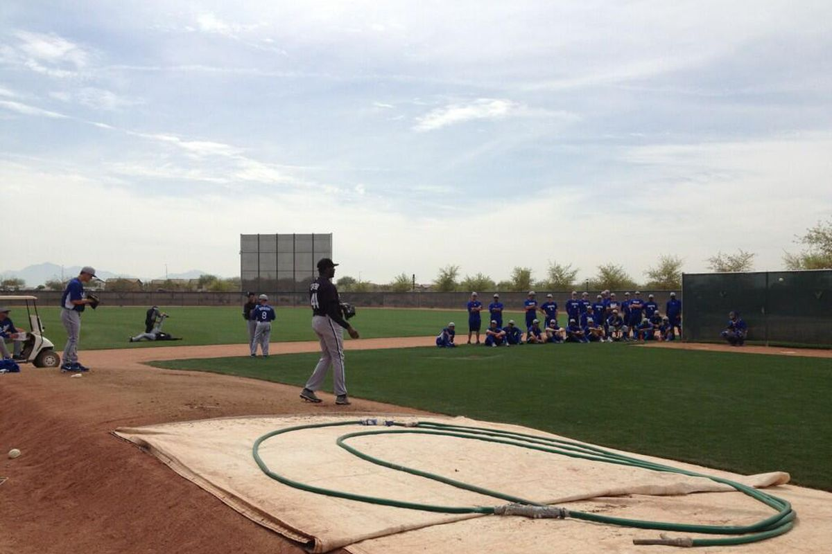 Several minor leaguers gathered to watch Zack Greinke warmup on Wednesday.