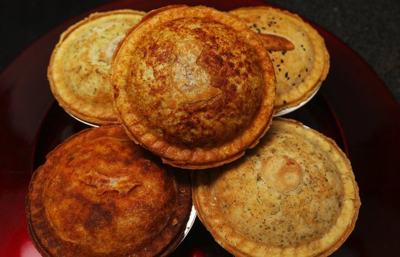 A stack of five pot pies