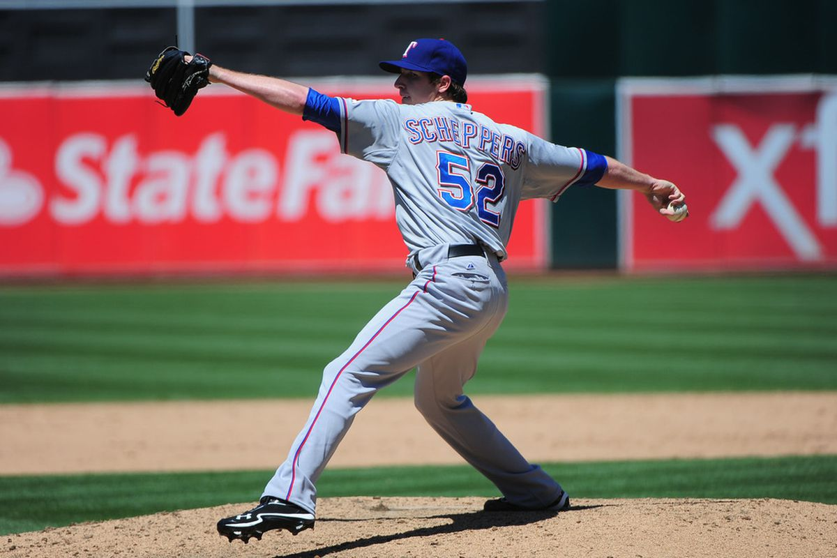 June 7, 2012; Oakland, CA, USA; Texas Rangers relief pitcher Tanner Scheppers (52) delivers a pitch during the sixth inning against the Oakland Athletics at O.co Coliseum. Mandatory Credit: Kyle Terada-US PRESSWIRE