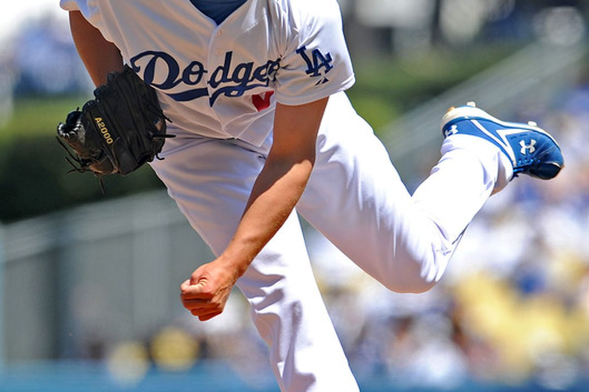 April 10, 2012; Los Angeles, CA, USA;  Los Angeles Dodgers starting pitcher Clayton Kershaw (22) pitches during the game against the Pittsburgh Pirates at Dodger Stadium. Dodgers won 2-0. Mandatory Credit: Jayne Kamin-Oncea-US PRESSWIRE