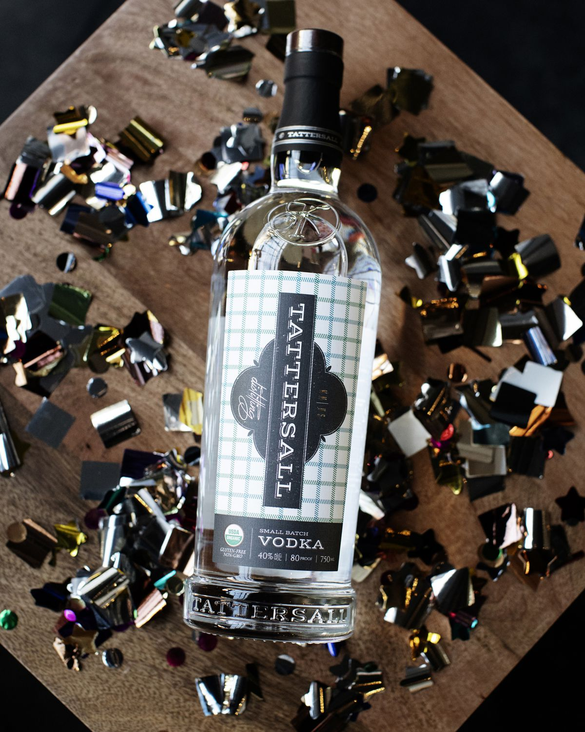 A bottle of Tattersall's vodka, on a table, surrounded by glitter confetti