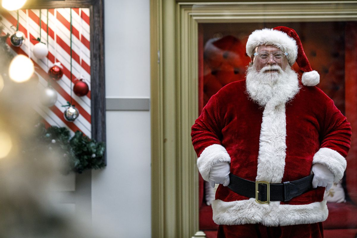 A man dressed as Santa Claus wears a protective face shield at Capital City Mall in Lower Allen Township, Pa., on Wednesday, Nov. 11, 2020.